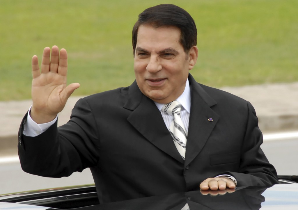 FILE - In this Oct.11, 2009 file photo, then Tunisian President Zine El Abidine Ben Ali waves from his car as he arrives at campaign rally in Rades, o...
