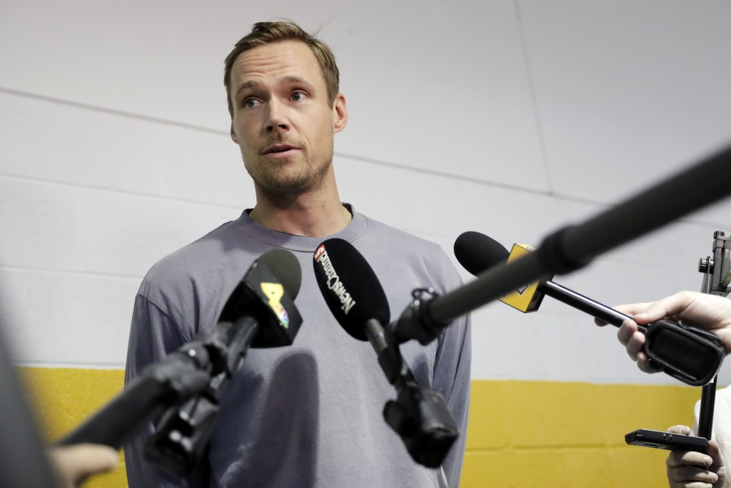Nashville Predators goaltender Pekka Rinne, of Finland, answers questions as players report to NHL hockey training camp Thursday, Sept. 12, 2019, in N...