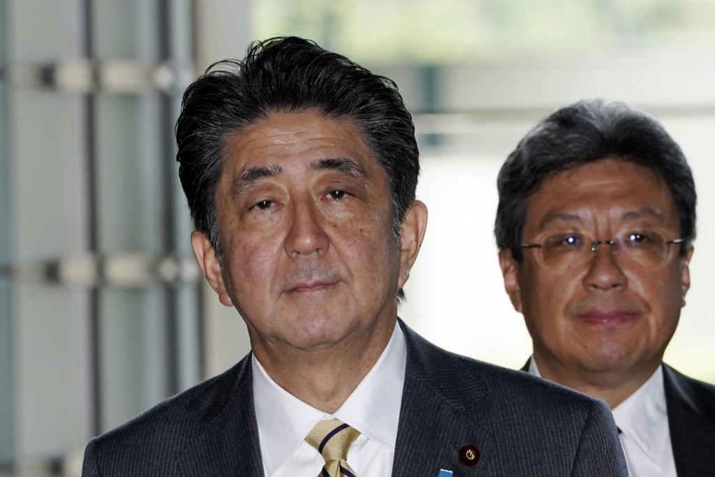 Japanese Prime Minister Shinzo Abe enters his official residence in Tokyo Wednesday, Sept. 11, 2019. Abe will reshuffle his Cabinet in a move that's l