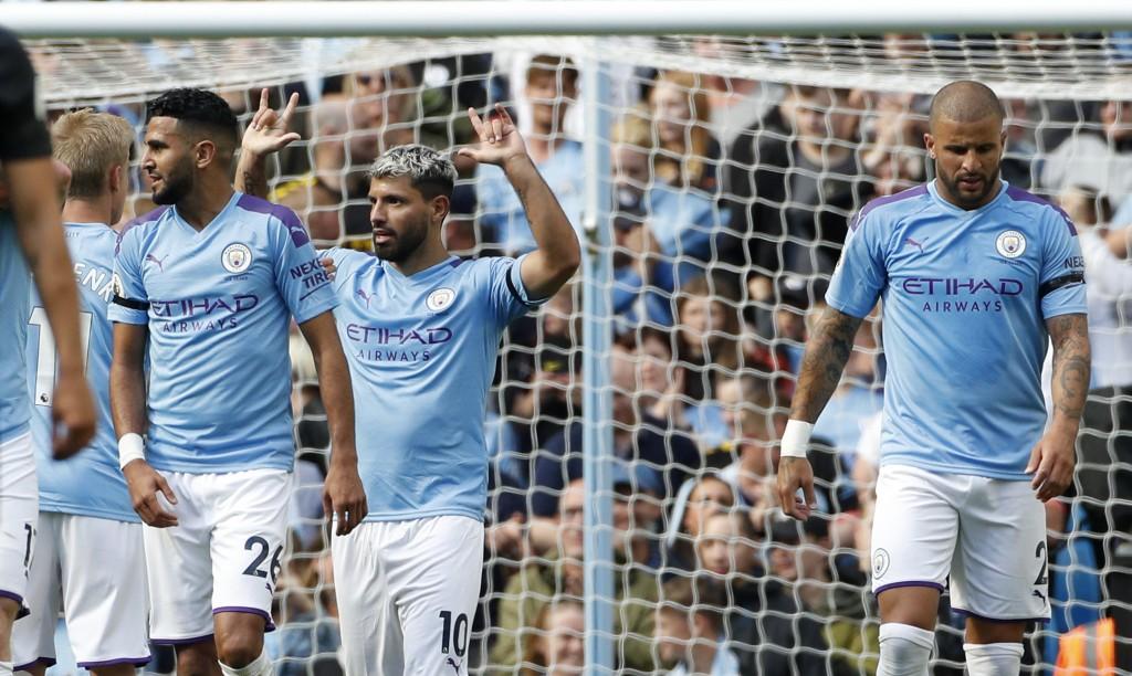 Manchester City's Bernardo Silva, center, celebrates after scoring his second goal during the English Premier League soccer match between Manchester C...