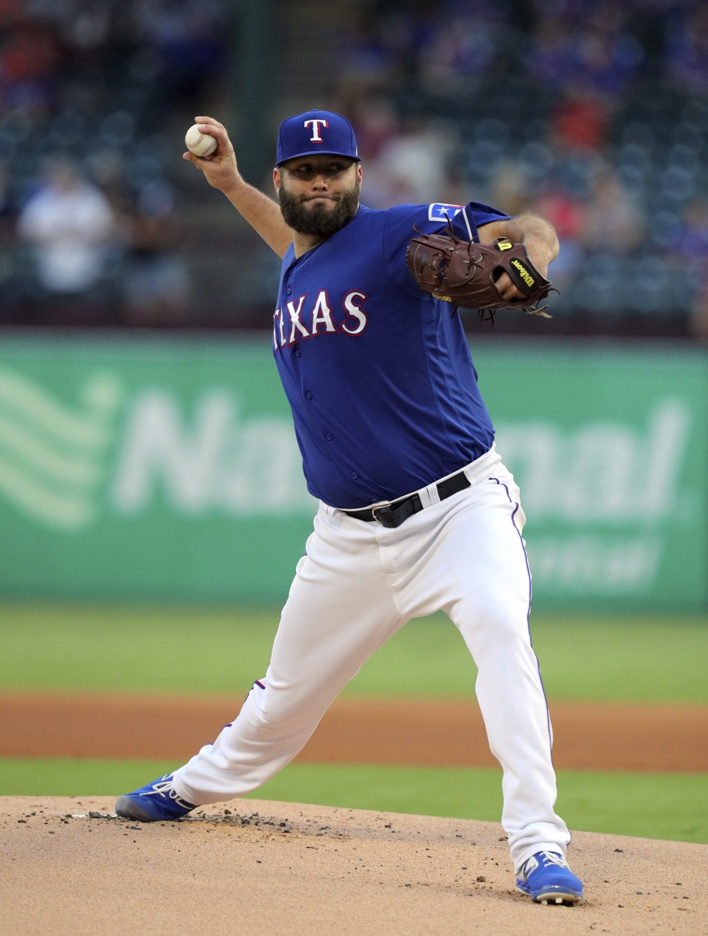 Texas Rangers starter Lance Lynn (35) delivers a pitch during the first inning of a baseball game against the Tampa Bay Rays Tuesday, Sept. 10, 2019, ...