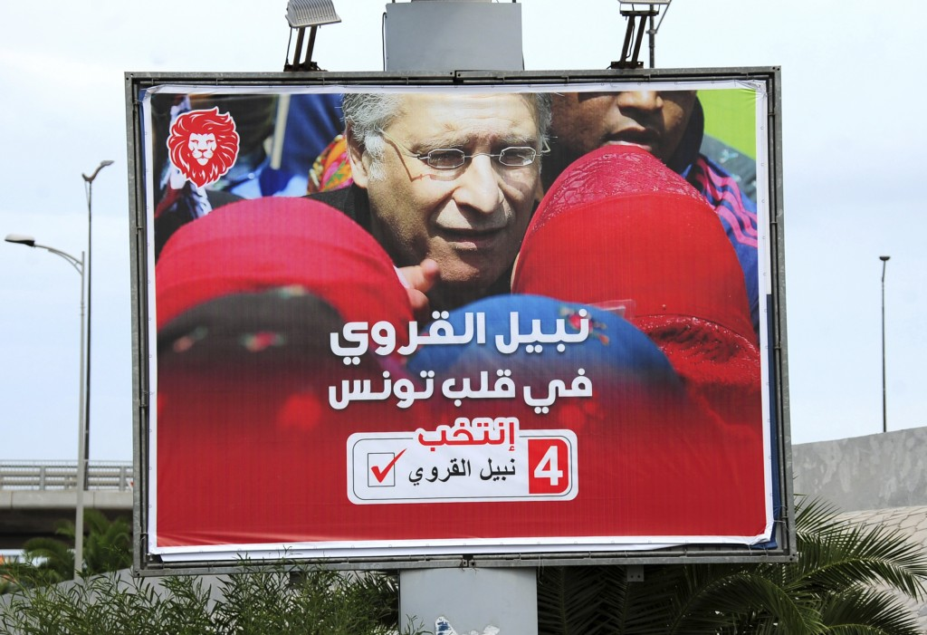 An electoral poster for jailed presidential candidate Nabil Karoui is pictured Tuesday Sept. 10, 2019 in Tunis. Tunisia's 26 presidential candidates l...
