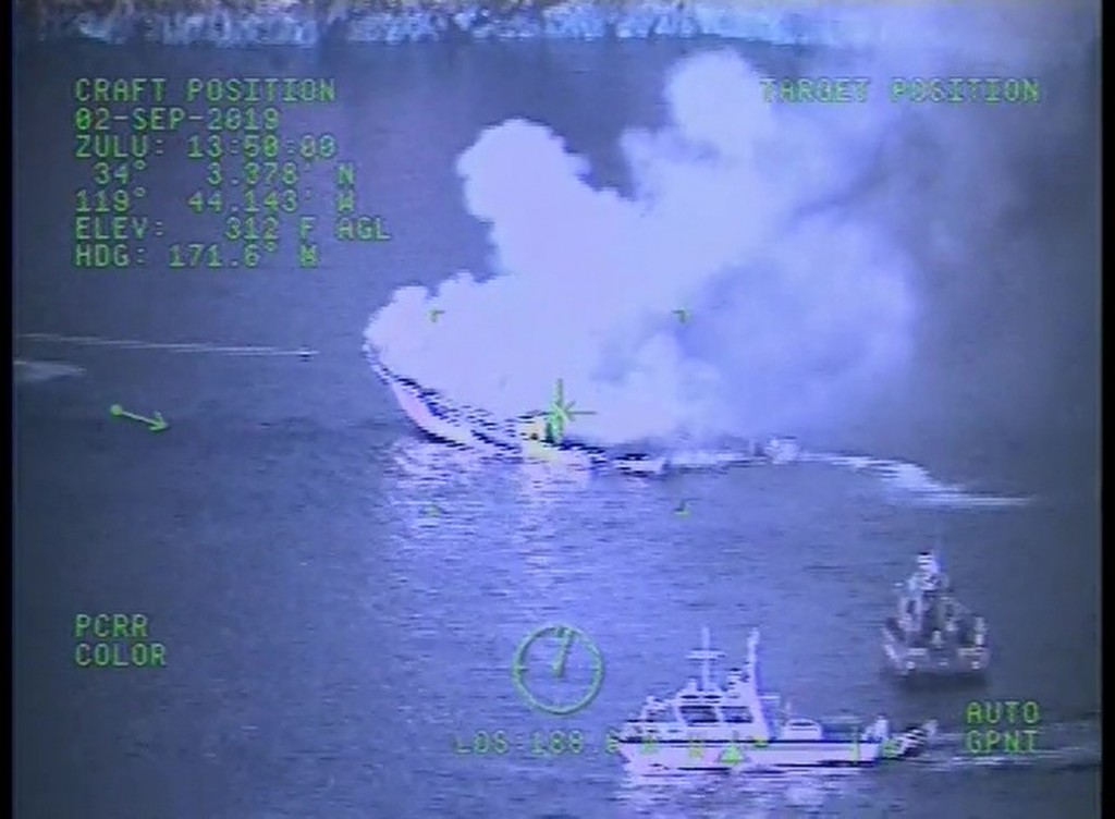 FILE - This Monday, Sept. 2, 2019, file image taken from video released by the U.S. Coast Guard shows a Coast Guard Sector San Diego MH-60 Jayhawk hel