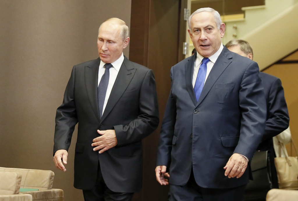 Russian President Vladimir Putin, left, and Israeli Prime Minister Benjamin Netanyahu enter the hall during their meeting in Sochi, Russia, Thursday, ...