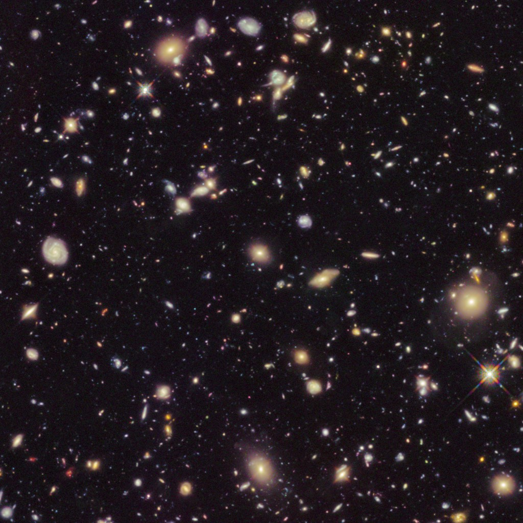 This image made available by the European Space agency shows galaxies in the Hubble Ultra Deep Field 2012, an improved version of the Hubble Ultra Dee