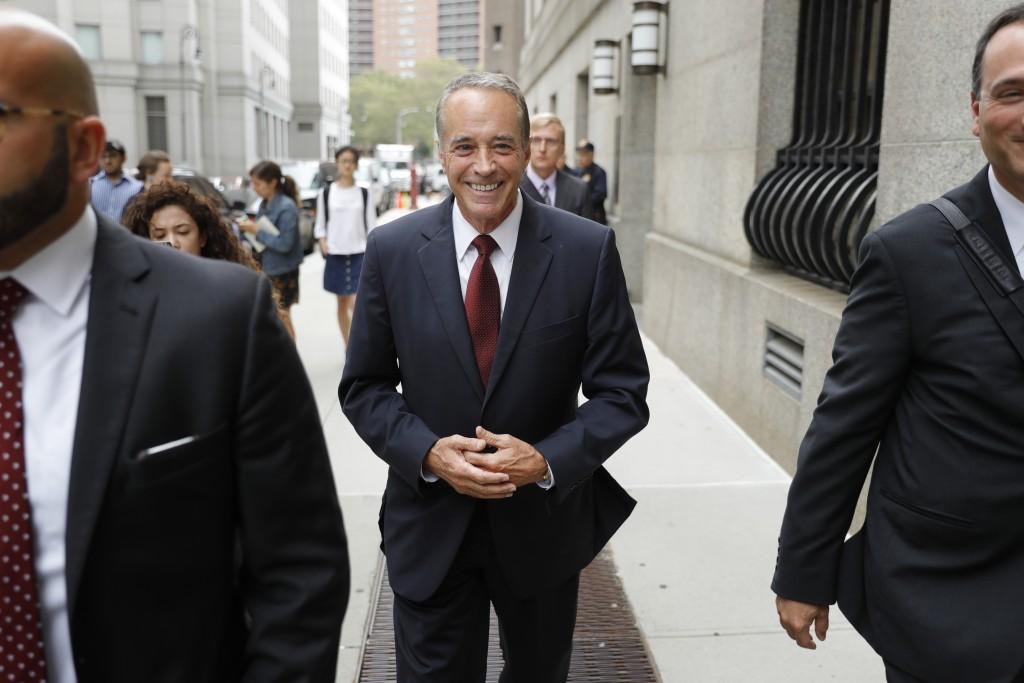 U.S. Rep. Chris Collins, R-N.Y., leaves the courth...
