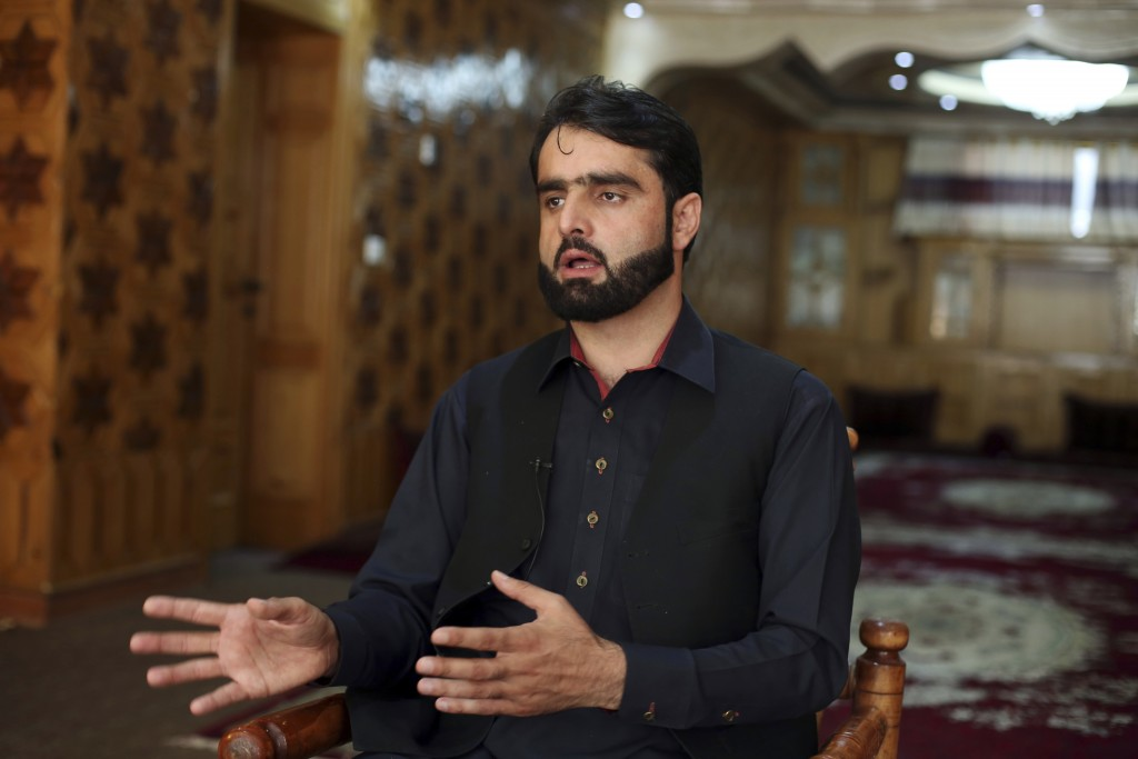 In this Tuesday, Sept. 10, 2019, photo, Maidan Wardak provincial council member Sharifullah Hotak, speaks during an interview to The Associated Press