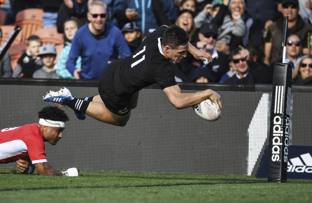 New Zealand's George Bridge is airborne as he dives across the line to score a try against Tonga during their rugby test match in Hamilton, New Zealan