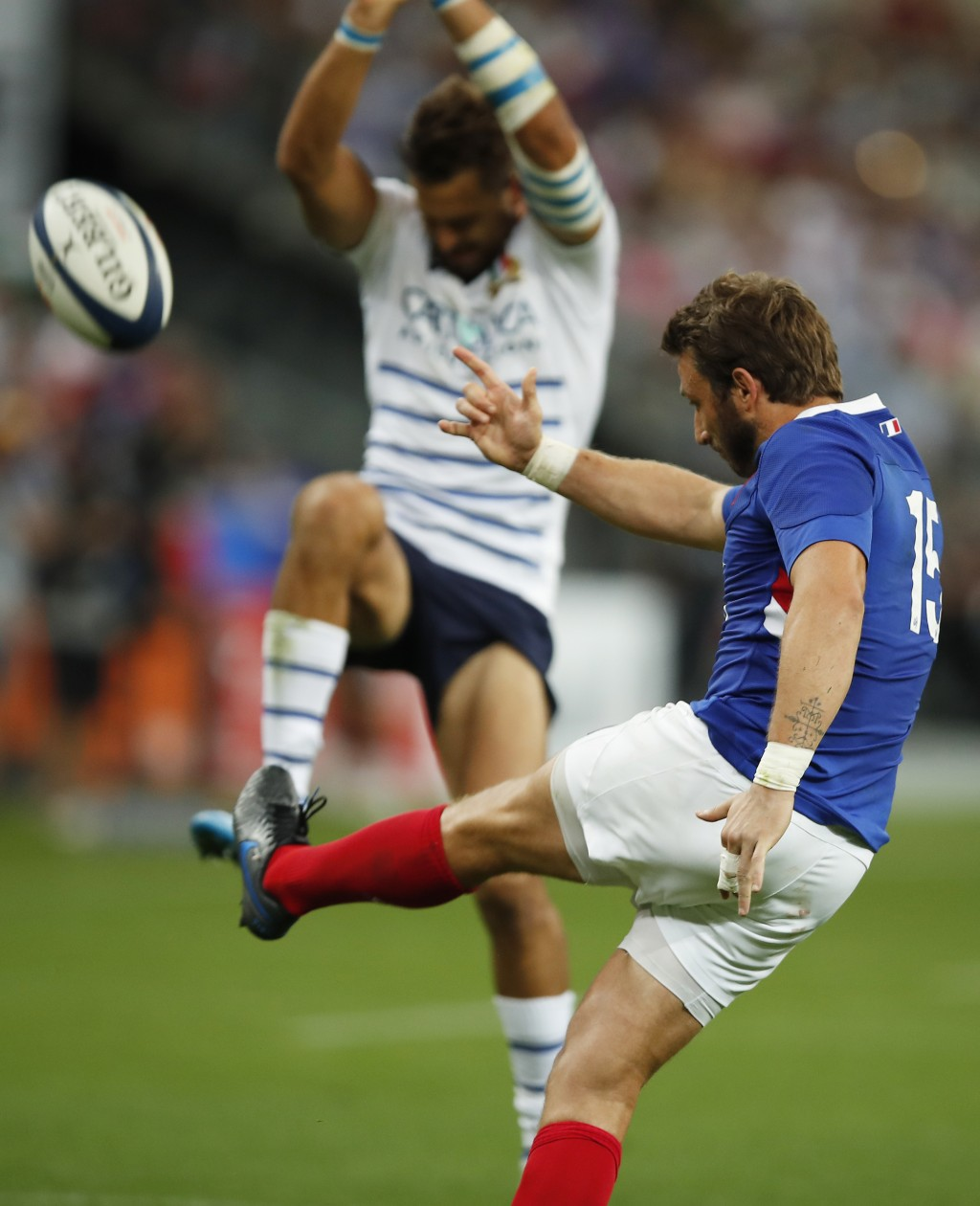 France's Maxime Medard kicks the ball during a friendly rugby test match between France and Italy at Stade de France in Saint Denis, north of Paris, F...