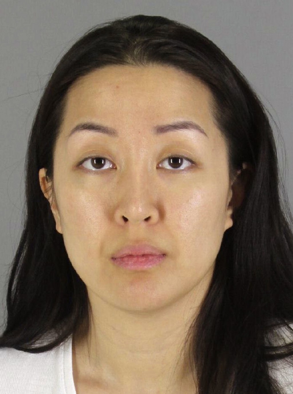 FILE - This undated booking photo provided by the San Mateo County, Calif., Sheriff's Office shows Tiffany Li. The trial of Li, a Chinese real estate