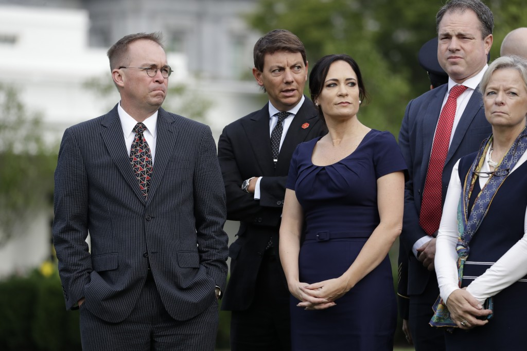 From left, acting White House Chief of Staff Mick Mulvaney, White House deputy press secretary Hogan Gidley and White House press secretary Stephanie ...