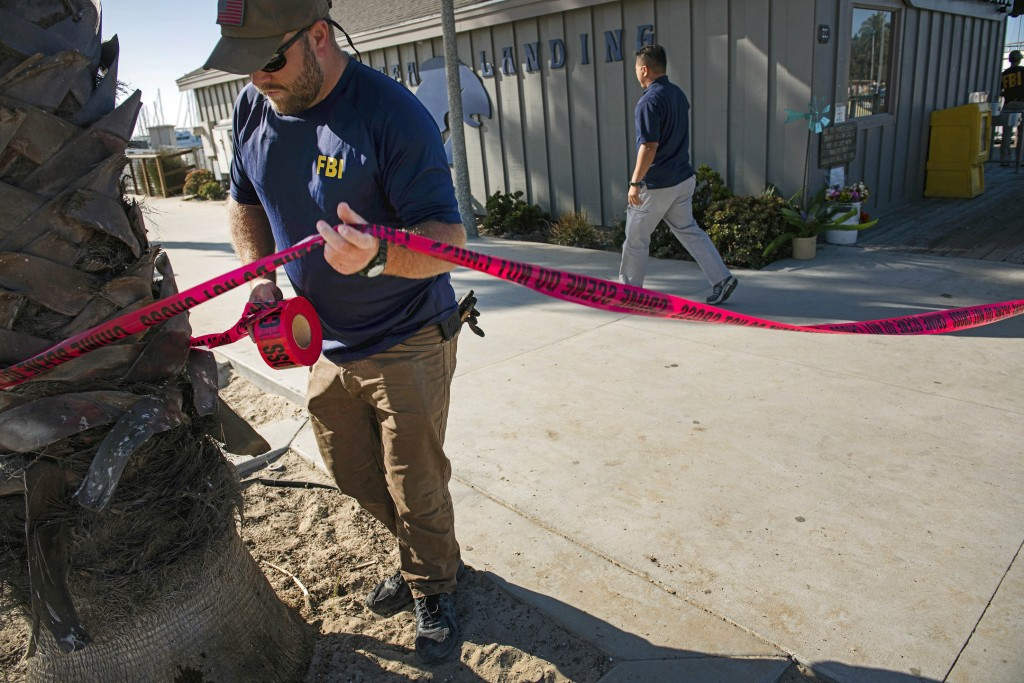 FILE - In this Sunday, Sept. 8, 2019 file photo, agents with the FBI set a perimeter around the Truth Aquatics office, the California company that own...