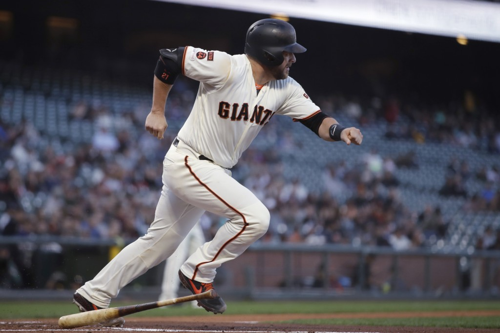 San Francisco Giants' Stephen Vogt runs after hitting a two-run single off Pittsburgh Pirates pitcher Mitch Keller during the first inning of a baseba...