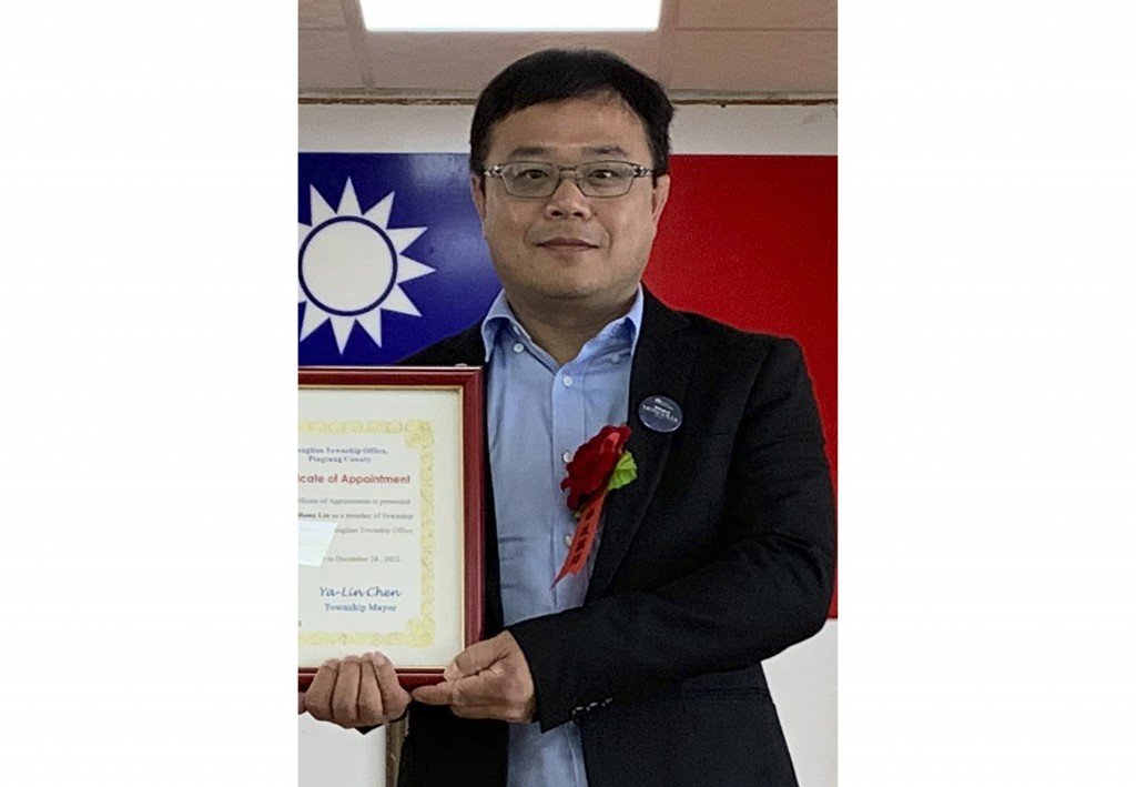 FILE - In this June 20, 2019, file photo released by Pingtung County Fangliao Township Office, Lee Meng-chu accepts a certificate for his adviser role...