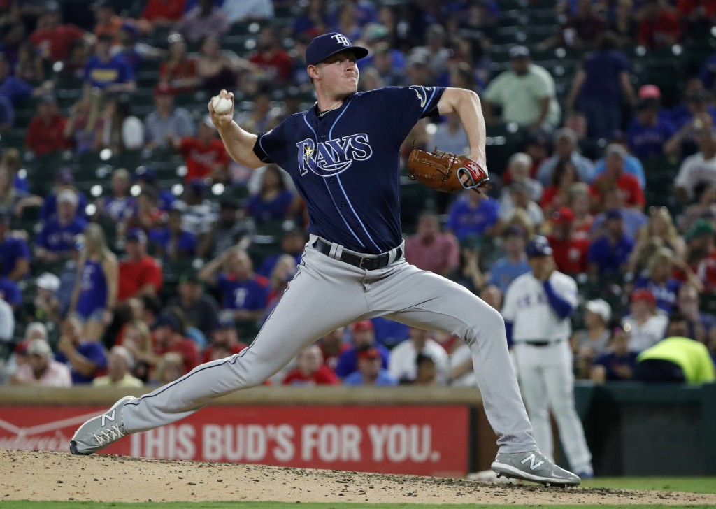 Tampa Bay Rays' Peter Fairbanks throws to a Texas Rangers batter during the fourth inning of a baseball game in Arlington, Texas, Thursday, Sept. 12, ...
