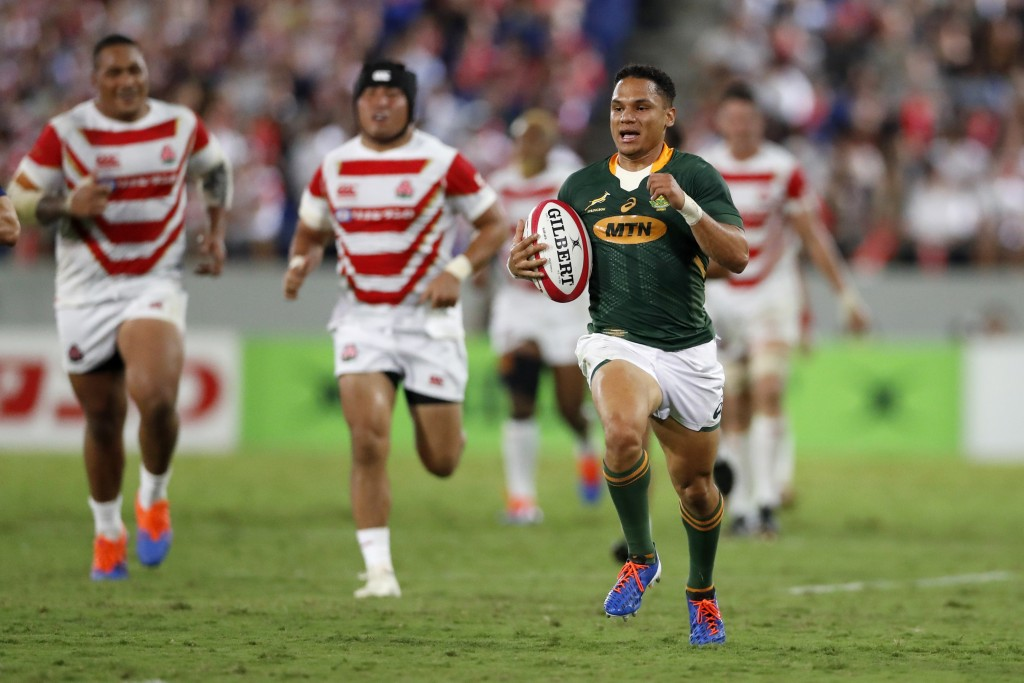 South Africa's Herschel Jantjies runs on his way to score a try during a rugby match against Japan at Kumagaya Rugby Stadium Friday, Sept. 6, 2019, in...