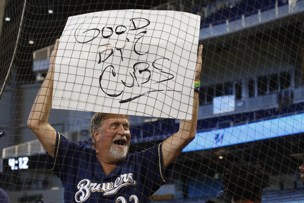 A Milwaukee Brewers fan holds up a sign after the team defeated the Miami Marlins in a baseball game Thursday, Sept. 12, 2019, in Miami. (AP Photo/Wil...