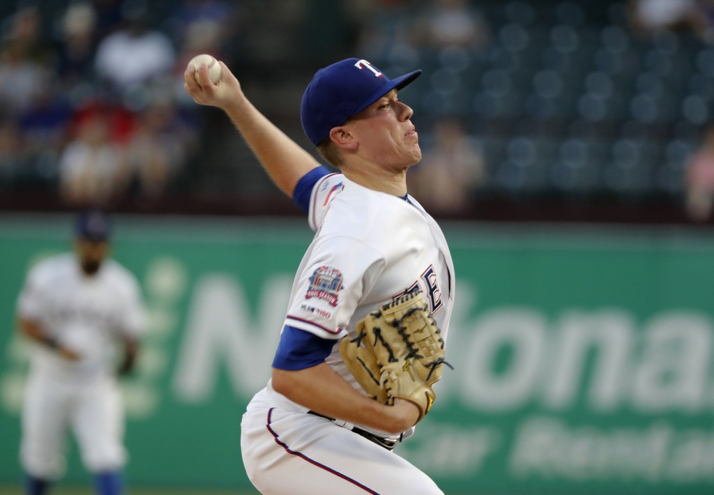 Texas Rangers starting pitcher Kolby Allard throws to a Tampa Bay Rays batter during the first inning of a baseball game in Arlington, Texas, Thursday...