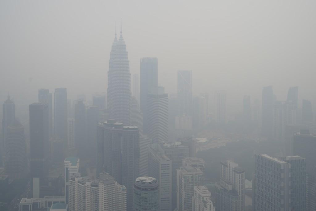 Kuala Lumpur city stands shrouded with haze in Kuala Lumpur, Malaysia, Friday, Sept. 13, 2019. Malaysian authorities plan to conduct cloud-seeding act...