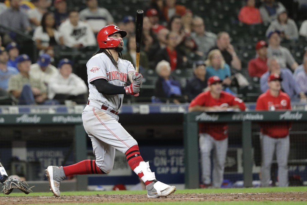 Cincinnati Reds' Freddy Galvis watches his grand slam in the seventh inning of the team's baseball game against the Seattle Mariners, Thursday, Sept. ...