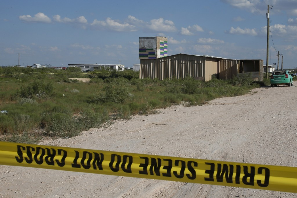 Crime scene tape surrounds the home of Seth Aaron Ator, the alleged gunman in a West Texas rampage Saturday, on Monday, Sept. 2, 2019, near Odessa, Te...