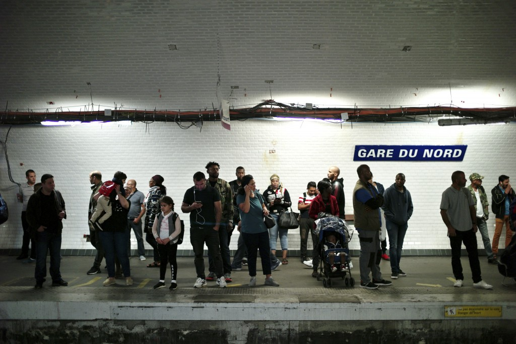 Commuters wait to board a train, in Gare du Nord railway station, in Paris, Friday, Sept. 13, 2019. Paris metro warns over major strike, transport cha...
