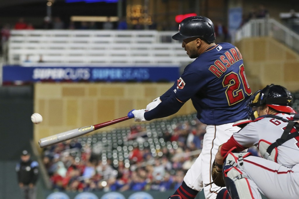 Minnesota Twins' Eddie Rosario hits an RBI-single off Washington Nationals' starting pitcher Patrick Corbin in the first inning of a baseball game Thu...