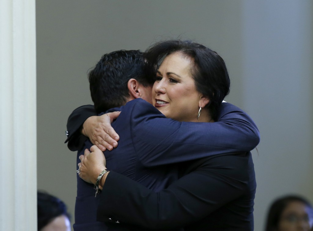 Assemblywoman Lorena Gonzalez, D-San Diego, receives congratulations from Assembly Speaker Anthony Rendon, of Lakewood after her to give new wage and