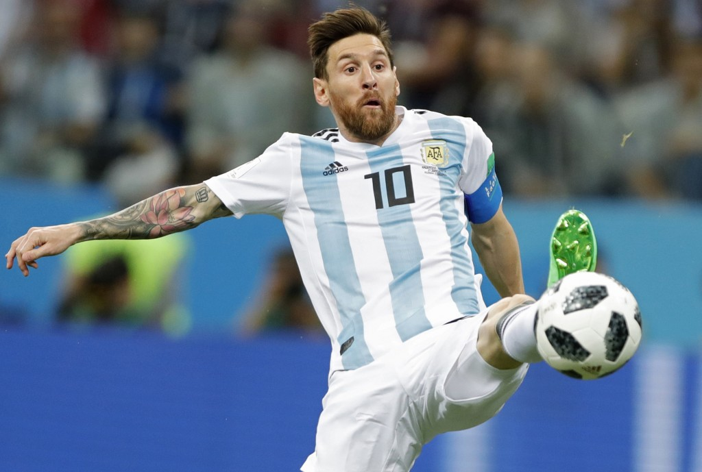 FILE - In this June 21, 2018 file photo Argentina's Lionel Messi reaches for the ball during the group D match between Argentina and Croatia at the 20