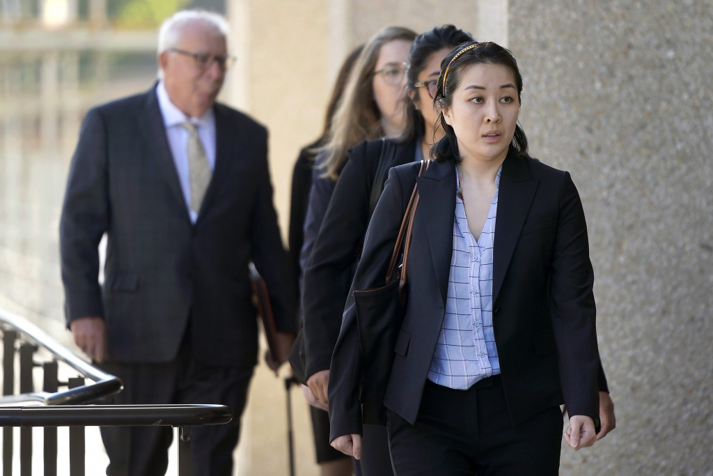 Tiffany Li, foreground, arrives at the courthouse Thursday, Sept. 12, 2019, in Redwood City, Calif. The trial of Li, a Chinese real estate scion who p