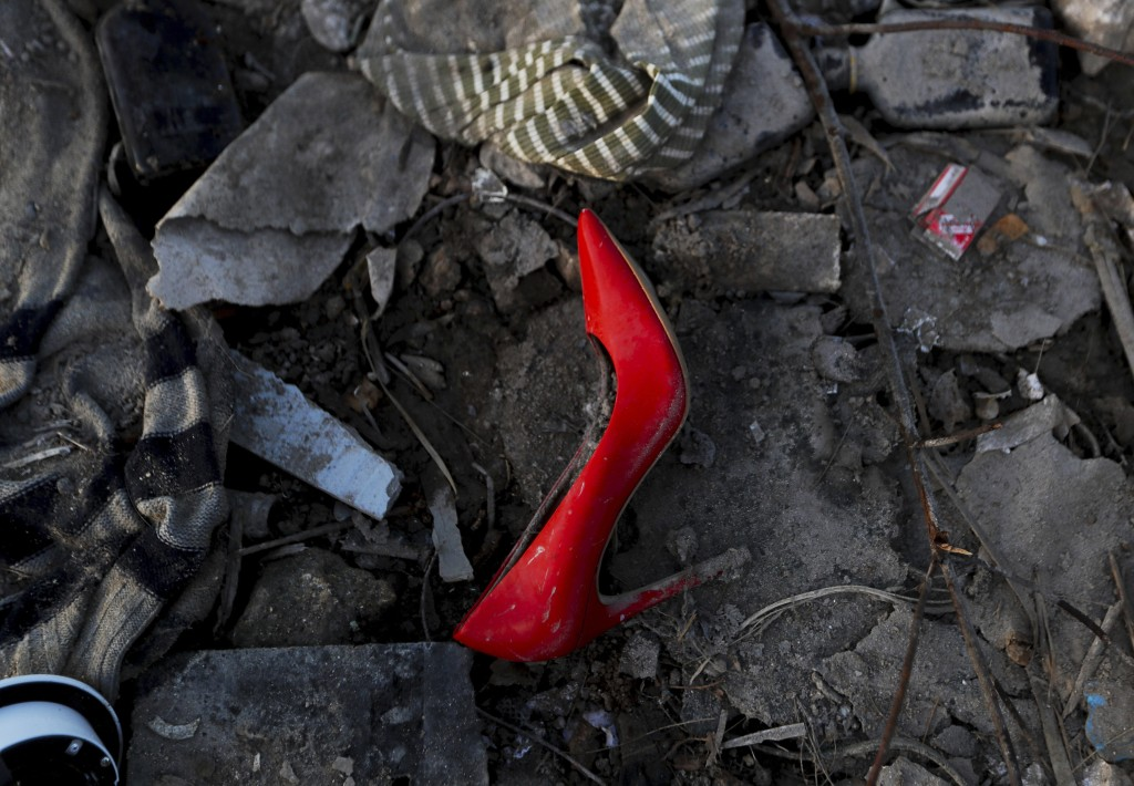 I this Sept. 8, 2019 photo, an abandoned high heel shoe lays in the mud in the aftermath of Hurricane Dorian in an area called The Mudd, in Marsh Harb