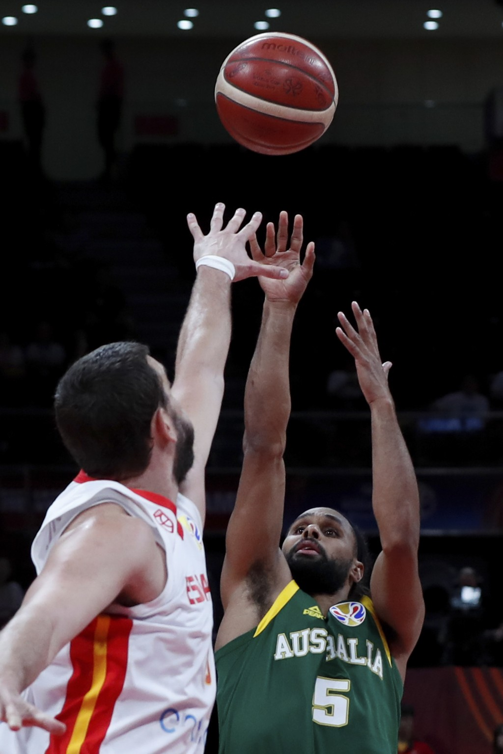Patty Mills of Australia puts a shot over Marc Gasol of Spain during their semifinals match for the FIBA Basketball World Cup at the Cadillac Arena in...