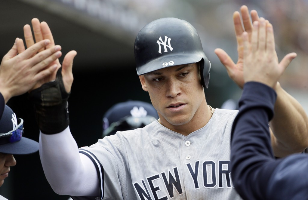 New York Yankees' Aaron Judge celebrates after scoring against the Detroit Tigers on a wild pitch during the seventh inning of the first game of a bas