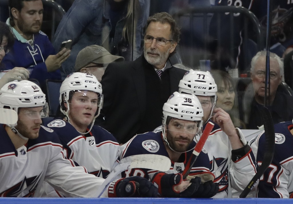FILE - In this Jan. 8, 2019, file photo, Columbus Blue Jackets coach John Tortorella stands behind player during the first period of the team's NHL ho...