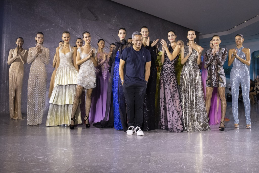 Designer Naeem Khan takes a bow after his collection was modeled during Fashion Week, Tuesday, Sept. 10, 2019, in New York. (AP Photo/Mary Altaffer)