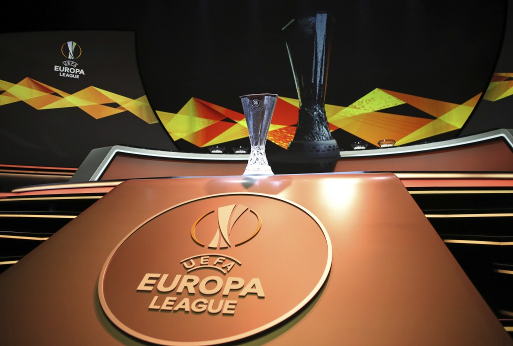 The Europa League trophy is put on display before the UEFA Europa League group stage draw at the Grimaldi Forum, in Monaco, Friday, Aug. 30, 2019. (AP...