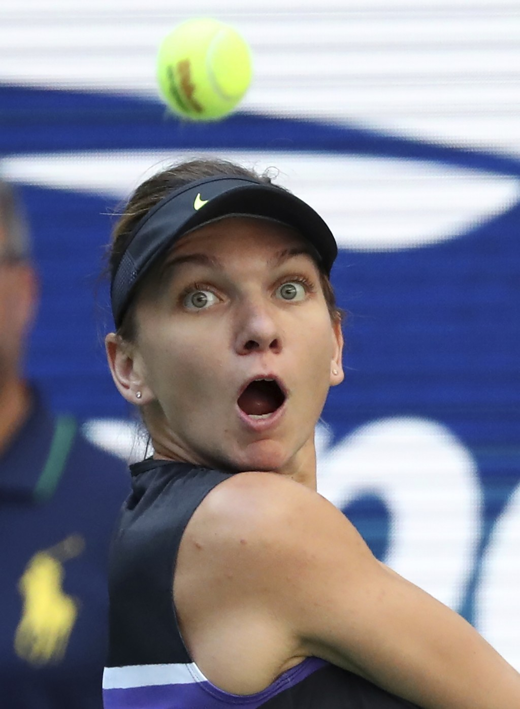 Simona Halep, of Romania, returns a shot to Taylor Townsend, of the United States, during the second round of the US Open tennis championships Thursda