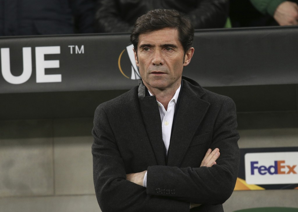 FILE - In this March 14, 2019, file photo Valencia coach Marcelino García Toral  watches from the sideline during a Europa League round of 16, second