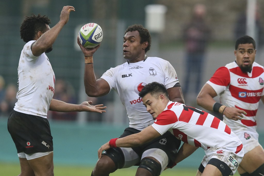 FILE - In this Nov. 26, 2016, file photo, Fiji's Leone Nakarawa, center, catches the ball during an international rugby union test match between Fiji ...