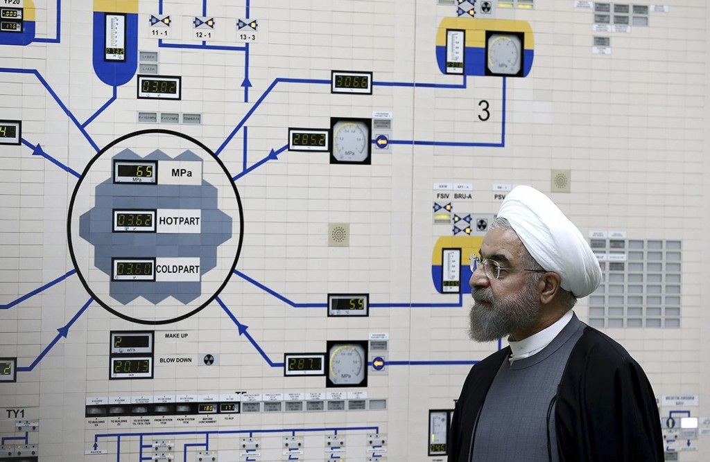 FILE - In this Jan. 13, 2015, file photo released by the Iranian President's Office, President Hassan Rouhani visits the Bushehr nuclear power plant j