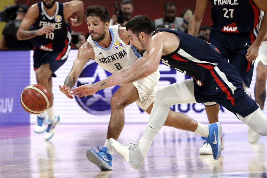 Nicolas Laprovittola of Argentina and Nando de Colo of France battle for a loose ball during their semifinal match in the FIBA Basketball World Cup at