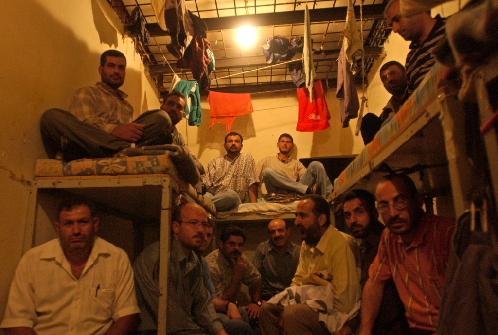 FILE - This August 3, 2005 file photo, Lebanese ex-inmates of the notorious Khiam prison sit in their former cells where they displayed their belongin...