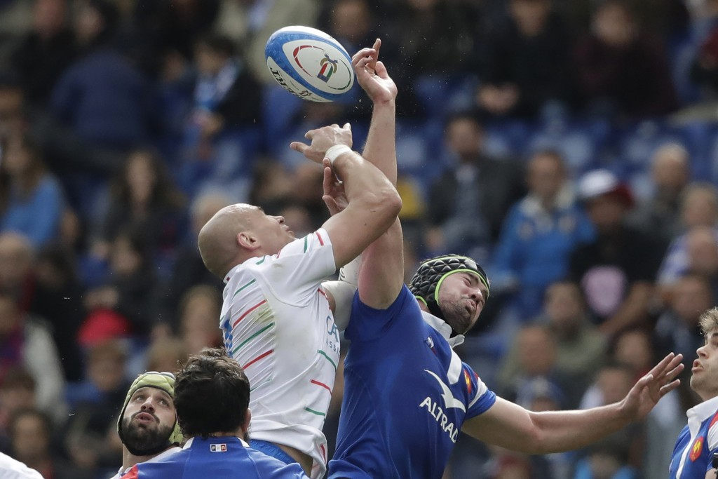 FILE - In this March 16, 2019, file photo, France's Gregory Alldritt, right, goes for the ball with Italy's Sergio Parisse during a Six Nations rugby ...