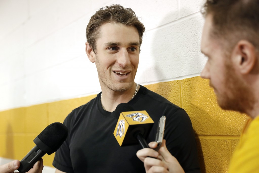 Nashville Predators center Kyle Turris answers questions as players report to NHL hockey training camp Thursday, Sept. 12, 2019, in Nashville, Tenn. (