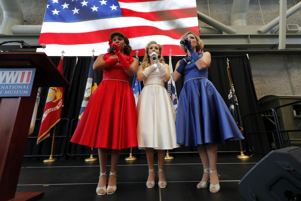 The Victory Belles sing the National Anthem as World War II veteran Lawrence Brooks celebrates his 110th birthday at the National World War II Museum