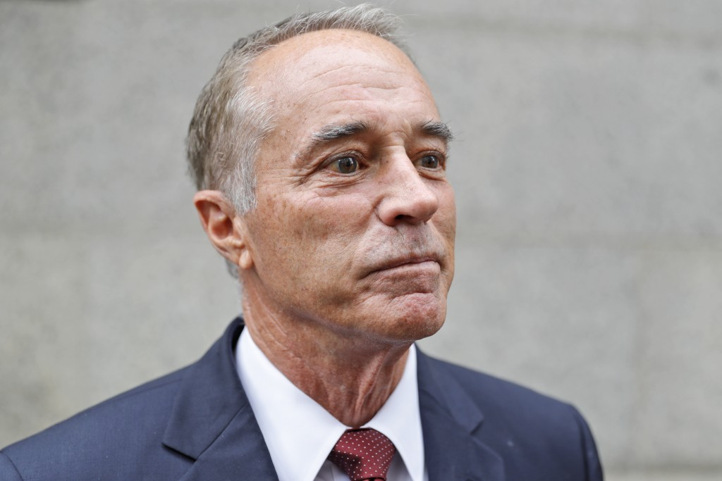 U.S. Rep. Chris Collins, R-N.Y., speaks to reporters as he leaves the courthouse after a pretrial hearing in his insider-trading case, Thursday, Sept....