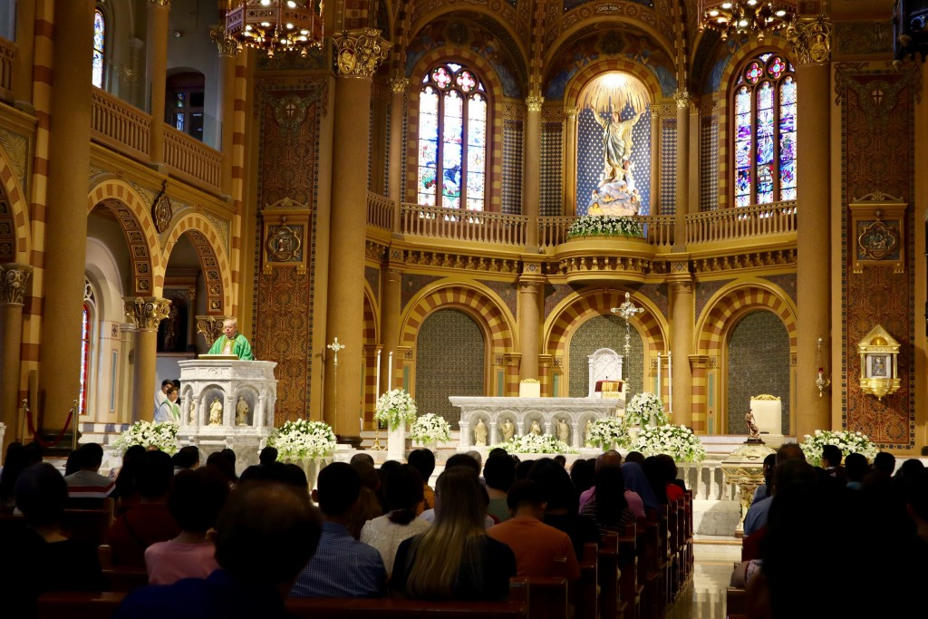 In this Sept. 8, 2019, photo, Catholic churchgoers attend a Mass in Bangkok, Thailand. The Vatican said Friday, Sept. 13, 2019, Pope Francis will visi