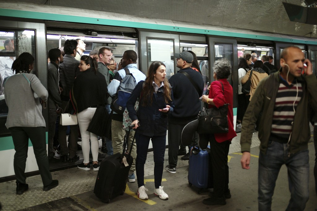 Commuters board a train, in Gare du Nord railway station, in Paris, Friday, Sept. 13, 2019. Paris metro warns over major strike, transport chaos Frida...