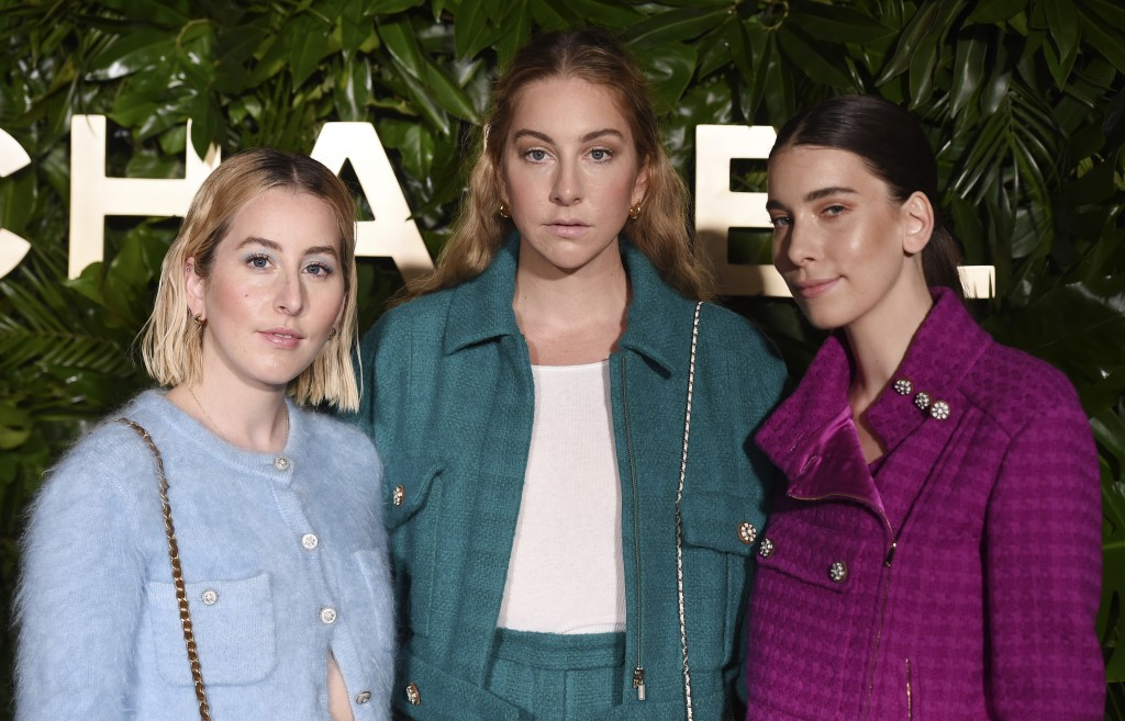 Sisters Alana, left, Este, center, and Danielle Haim of the band HAIM pose together at the launch of the Gabrielle Chanel Essence fragrance at the Cha