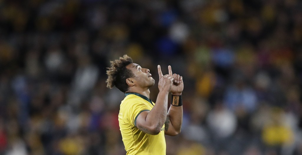 Australia's Will Genia points upwards as he leaves the field during their rugby union test match against Samoa in Sydney, Saturday, Sept. 7, 2019. (AP